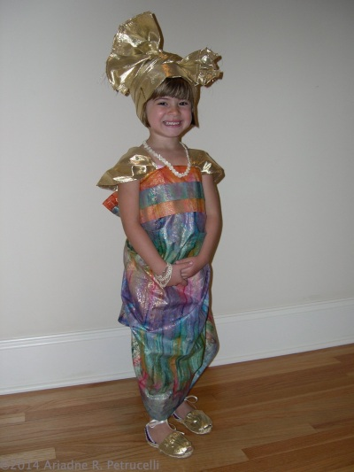 My daughter smiling in the African dress I sewed her for a pre-school international event.